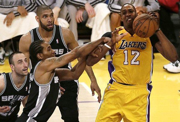 Lakers center Dwight Howard is fouled by Spurs forward Kawhi Leonard in first half of Game 3 on Friday night at Staples Center.