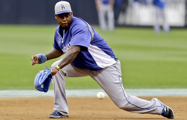 Dodgers shortstop Hanley Ramirez fields a grounder during a workout before a game in San Diego.