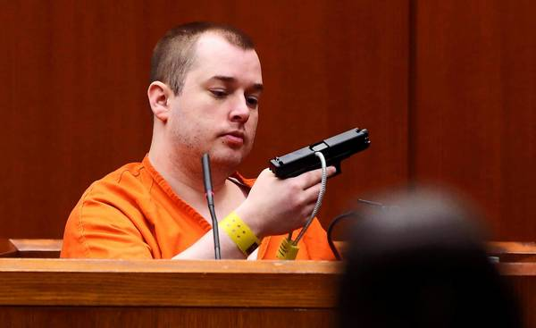 Jacob Nodarse, who pleaded guilty to killing three members of the Kramer family, holds the gun prosecutors say he used to kill Michael Kramer and his parents, Jeffrey and Lori. Nodarse testified Friday for the prosecution in a the murder trial of Johnny Borizov at the DuPage County courtroom in Wheaton.