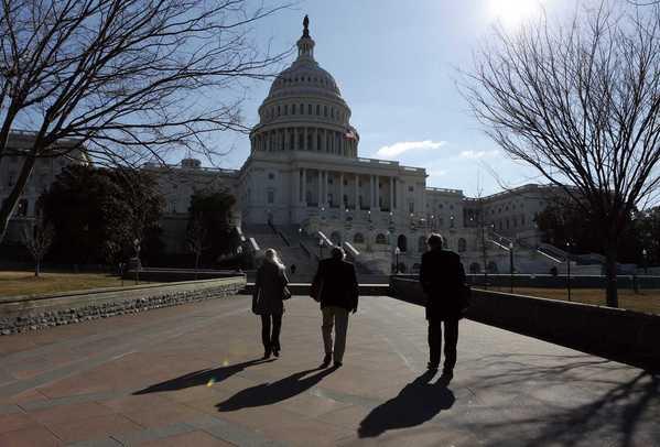 People walk toward the U.S. Capitol in Washington March 4, 2013.