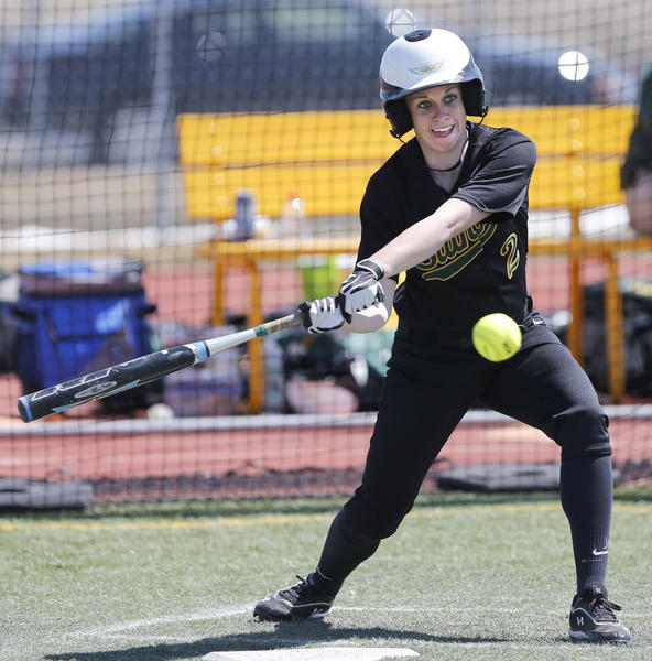 Presentation College's Kelsey Schmidt takes a swing at a pitch during Friday's second game against Dakota State University at Swisher Field.