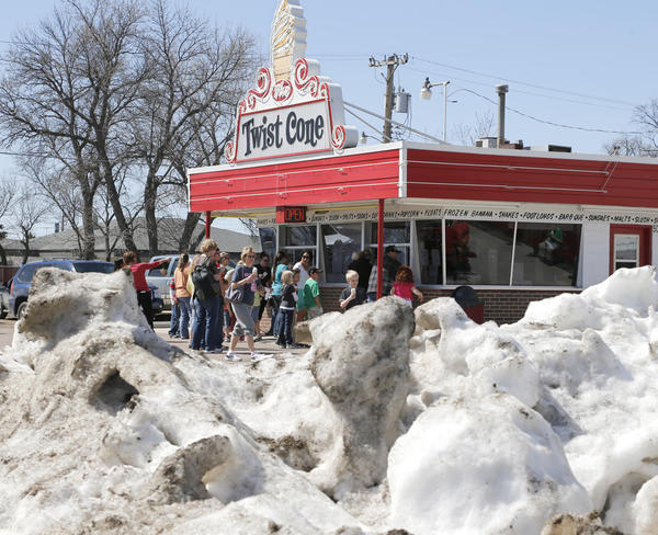 The snow pile on the corner of the lot may look deceiving but area residents enjoyed temperatures in the 70's Friday with a cool treat at Twist Cone. photo by john davis taken 4/26/2013
