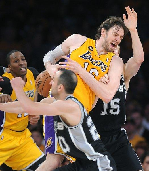 Pau Gasol, top, will undergo a medical procedure to remove scar tissue in both of his knees on Thursday, according to a Lakers release.