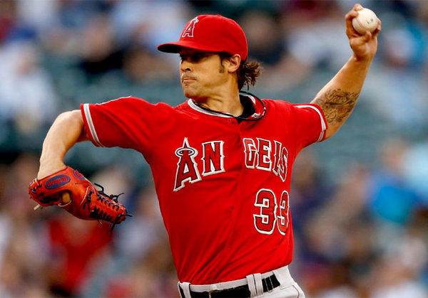 Angels starter C.J. Wilson pitches against the Seattle Mariners.