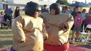 Enrique Zamora 13, from Brawley (red) and Eimer Valdez 13 from Brawley take part in Sumo Wrestling.
