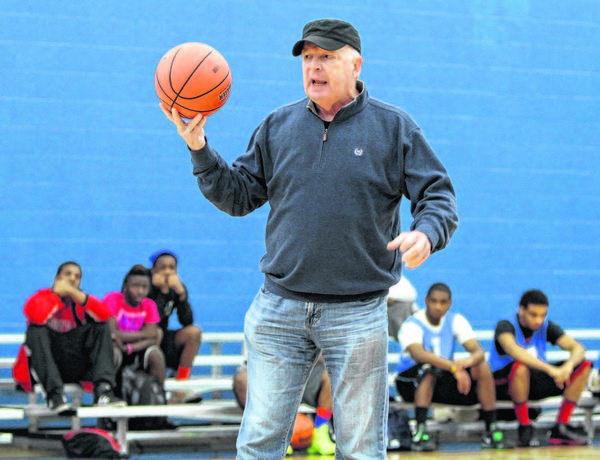 "Former Notre Dame basketball coach Richard ""Digger"" Phelps talks Saturday to the 140 players in the basketball league for at-risk males he organized last summer at South Bend's Kroc Center as part of a community effort to curb youth street violence."