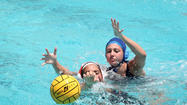 Koral LaStella, from Westminster Academy (blue cap), fights for the ball against Ashley Tobin, from Winter Park, during the state water polo tournament. (Cristobal Herrera, Sun Sentinel)