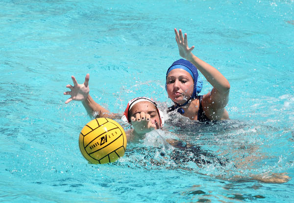 (CH) os-fl-state-water-polo-brow-0426-Chi-- Koral LaStella, from Westminster Academy, blue cap, fight for the ball against Ashley Tobin, from Winter Park, during the state water polo tournament at Ransom Everglades High School in Miami on April 26, 2013 Staff photo/Cristobal Herrera Sun-Sentinel