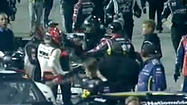 The post-race fight Friday night between NASCAR Nationwide Series drivers Nelson Piquet Jr. and Brian Scott spilled over into the motor home parking area of Richmond International Raceway afterward and led to the arrests of two Richard Childress Racing crew members.