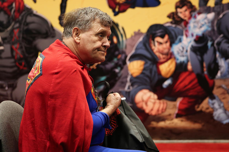 Superman Joseph Horn of Riverdale, Ill., takes a short rest as he perused the booths during the annual C2E2 Chicago Comic and Entertainment Expo Friday, April 26, 2013 at McCormick Place in Chicago. Horn had the name Superman legally added to the beginning of his own.