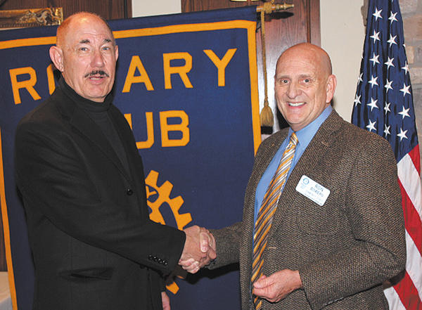 Art Schneider, left, is welcomed by Ron Bowers, Long Meadows Rotary Club president.