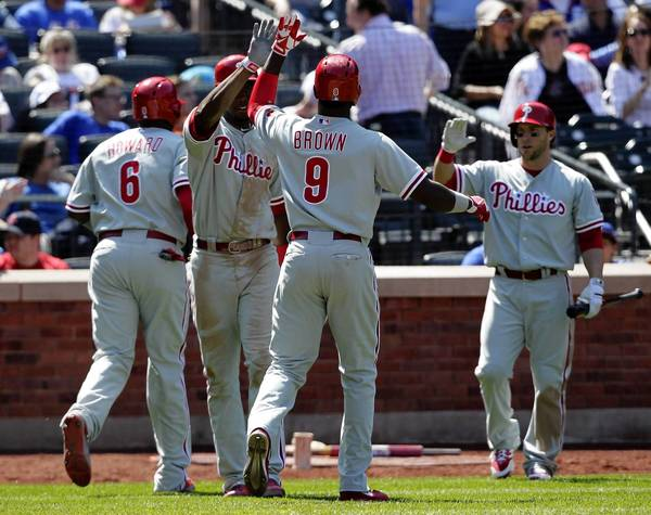 Domonic Brown #9 of the Philadelphia Phillies (C) celebrates his three run home run with his teammates in the fifth inning against the New York Mets at Citi Field on April 27, 2013 in the Flushing neighborhood of the Queens borough of New York City.