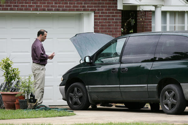 James Everett Dutschke works on his mini-van in his driveway in Tupelo, Miss., on Friday. Hours later, Dutschke was arrested in connection with poison letters sent to President Obama and others.
