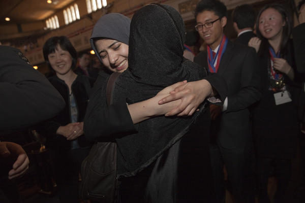 Granada Hills Charter High School senior Hamidah Mahmud of Granada Hills Charter is comforted by her mother, Jahanara, after her team won the state competition last month. The students proceeded to nationals, where they won their third consecutive title.