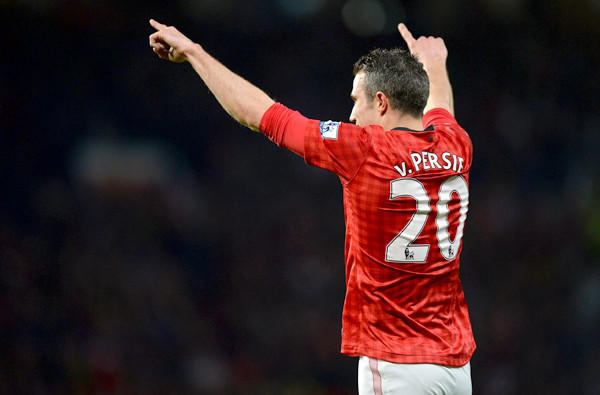 Manchester United forward Robin Van Persie celebrates after scoring three goals against Aston Villa during an English Premier League game last week at Old Trafford.