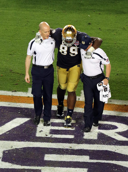 Notre Dame defensive end Kapron Lewis-Moore is helped by trainers after an injury during the first half of the 2013 BCS Championship game against Alabama. The Ravens drafted Lewis-Moore in the sixth round.