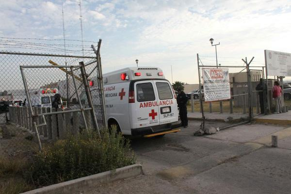 A photo provided by the Pulso Diario de San Luis newspaper shows ambulances evacuating wounded people from La Pila prison in Mexico's San Luis Potosi state