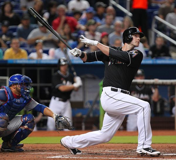 Miami Marlins first baseman Joe Mahoney hits a solo home run during the fourth inning of the game against the Chicago Cubs at Marlins Park in Miami on Friday, April 26, 2013.