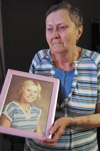 "Sandra Volneck of Hagerstown holds the photo of her daughter, Loraine ""Lori"" Zimmerman, whose murder at the age of 15 remains unsolved nearly three decades later."