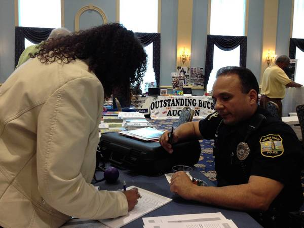 Linda Faussett, who works in Newport News, requests informational brochures from the Virginia Beach Police Department at the states third Substance Abuse Awareness Vital for Virginia Youth expo at Christopher Newport University on Saturday.