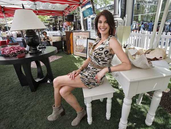 Actor Teri Hatcher relaxes on furniture for sale at Americana at Brand's Celebrity Yard Sale in Glendale on Saturday, April 27, 2013. Hatcher hosted the event that included a silent auction. The benefit event was held for the Juvenile Arthritis Association.