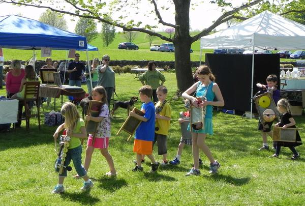 A group of kids play along with Slim Harrison's Sunnyland Band on Saturday during Renfrew Institute's Earth Celebration Day and Festival of Art.