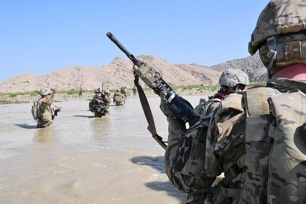 U.S. soldiers cross the Tarnak river in Kandahar province, Afghanistan, this month on a mission to clear the area of explosives caches. The Taliban has announced that the launch of its spring offensive on April 28, 2013, signaling stepped up attacks as the weather warms.