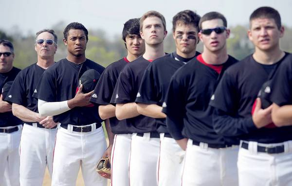 Nick Beinlich (third from left) during the National Anthem before Easton played Dieruff at Easton Area High School in Easton on Wednesday.