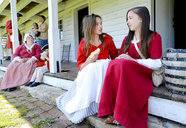 Morgan Taylor,12, left, of Sharpsburg talks with fellow living historian Elisabeth Rogers, 13, of Savage Md., inside the fort during Saturday's Market Fair at Fort Frederick State Park.