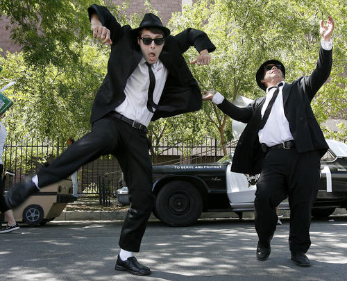 Danny Gill, left of Glendale, and John Gonzalez of Corona dance in the streets while dressed up as the Blues Brothers during the 2013 Doo Dah Parade in Pasadena on Saturday, April 27, 2013.