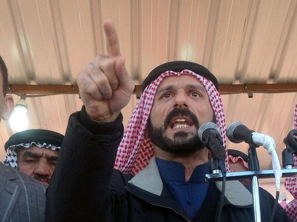 "Sheik Ali Hatem Suleiman speaks to a crowd in February. ""The Iraqi government is trying to get any excuse to attack Anbar,"" he says."