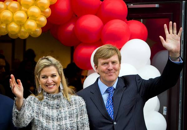 Dutch Crown Prince Willem-Alexander and Princess Maxima greet the public Friday at an event in Enschede.