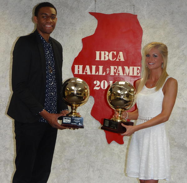 Simeon's Jabari Parker and Mount Carmel's Tyra Buss pose with their Mr. and Ms. Basketball of Illinois trophies at the Illinois Basketball Coaches Association banquet in Normal, Ill.