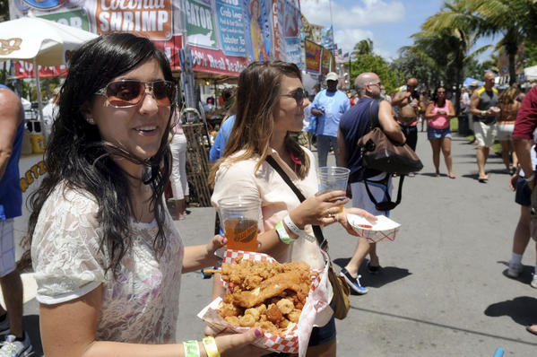 Nova Southeastern University students Stephanie Pancotto and Brittany Woodby selected the Captain's Platter on Saturday at the 29th annual Pompano Beach Seafood Festival. The festival continues Sunday on the beach near the Pompano pier.