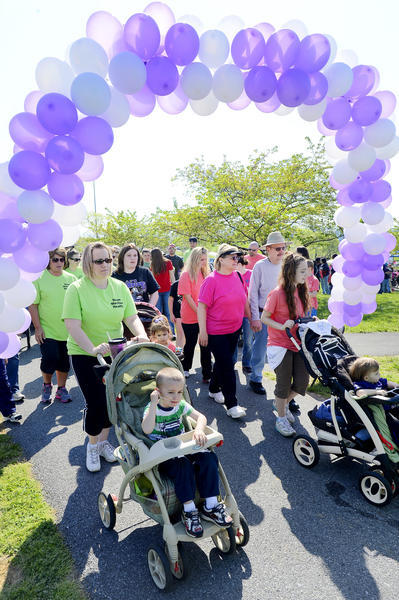 Participants in the 2013 March of Dimes March for Babies step off the starting line Saturday morning at Hagerstown's Fairgrounds Park.