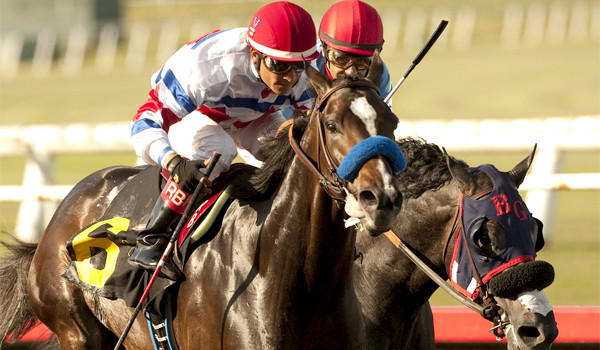 Donald R. Dizney's Surfcup and jockey Rafael Bejarano, left, hold off Fighting Hussar with jockey Victor Espinoza, right, to win the $300,000 Snow Chief Stakes horse race at Betfair Hollywood Park on Saturday.
