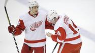 Captain Henrik Zetterberg scored two goals and set up another while Jimmy Howard made 17 saves en route to his second shutout in four games as visiting Detroit clinched a playoff spot for the 22nd consecutive season.