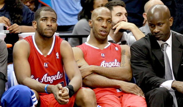 Chris Paul and Chauncey Billups look on from the Clippers' bench as L.A. was routed in a loss to the Grizzlies in Memphis, 104-83.