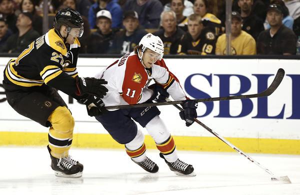 Apr 21, 2013; Boston, MA, USA; Florida Panthers center Jonathan Huberdeau (11) tries to get around Boston Bruins defenseman Dougie Hamilton (27) during the third period of a NHL game. Mandatory Credit: Winslow Townson-USA TODAY Sports ORG XMIT: USATSI-126292