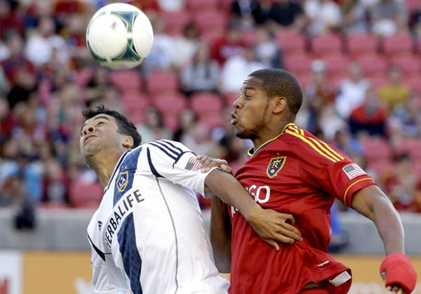 Galaxy forward Charlie Rugg, left, battles with Real Salt Lake defender Chris Schuler (28) during the first half.