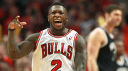 With 7 minutes 25 seconds left in the game of Nate Robinson's life Saturday at the United Center, Nets forward Gerald Wallace set a backcourt screen that created a collision loud enough to make NFL draft highlights too.