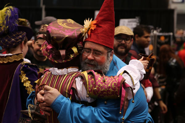 Ray Hocevar, dressed as a nome, gets a hug from a fellow convention goer during the second day of the annual C2E2 Chicago Comic and Entertainment Expo Saturday, April 27, 2013 at McCormick Place in Chicago.