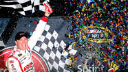 Kevin Harvick won Saturday night's race at Richmond (Va.) International Raceway by plowing through traffic on a two-lap sprint to the finish.