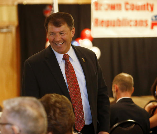 Former South Dakota Governor Mike Rounds visits with a group at Saturday night's Lincoln Day Dinner at the Ramada Inn. American News Photo by John Davis