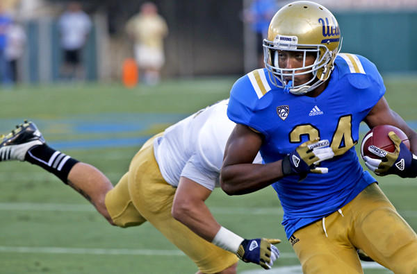 Bruins running back Paul Perkins turns the corner on a run during the spring game Saturday at the Rose Bowl.