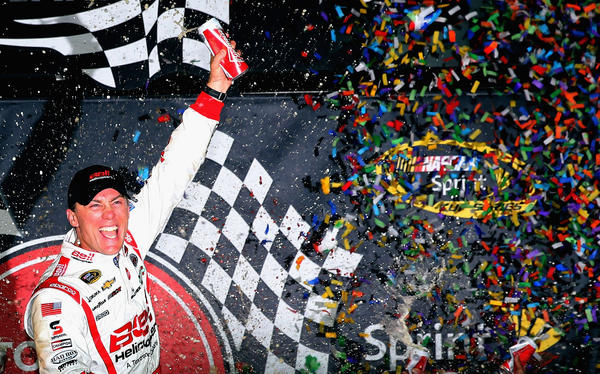 Kevin Harvick, driver of the #29 Bell Helicopter Chevrolet, celebrates in Victory Lane after winning the NASCAR Sprint Cup Series Toyota Owners 400 at Richmond International Raceway.