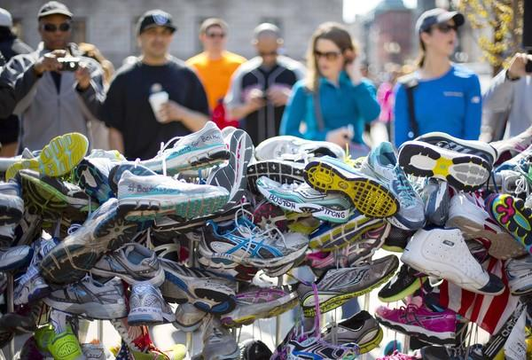 Running shoes are part of a makeshift memorial in Copely Square honoring victims of the Boston Marathon bombing.