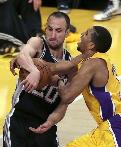 Lakers point guard Darius Morris, who had 24 points, is tied up by Spurs guard Manu Ginobili on a drive in the second half Friday night.
