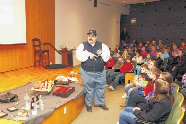 Travis Childs talks about the Civil War to kids at the Center for History in South Bend.