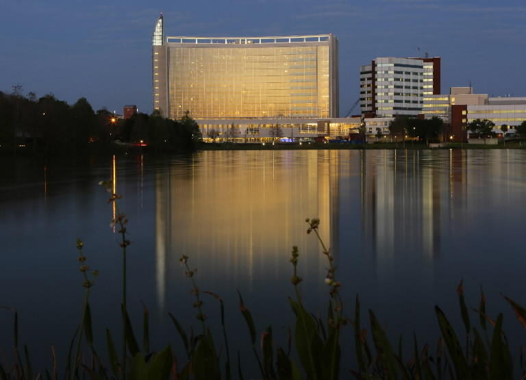 The rising sun reflects on Florida Hospital's Ginsburg Tower, Monday, March 12, 2013.